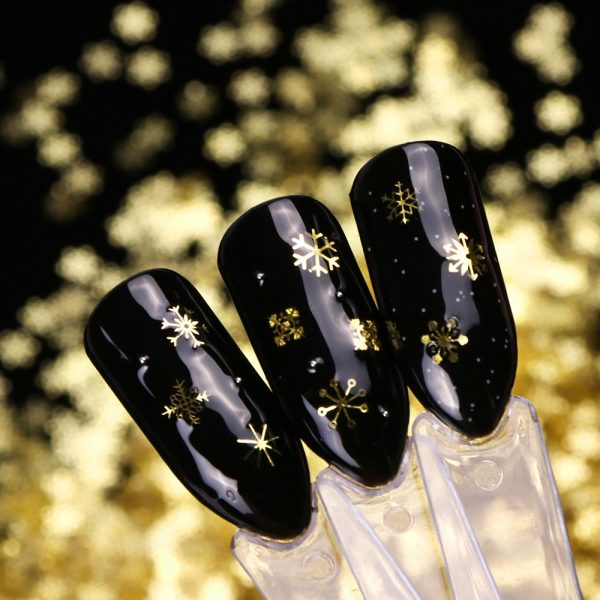beautiful nail with gold glitter designs in polished ease